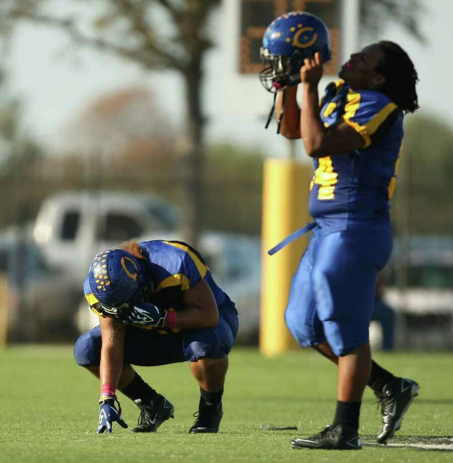 Channelview's John Guyton (left) collects his thoughts after the Falcons' 47-44 loss to PA Memorial, Saturday, October 15, 2011 at Stallworth Stadium in Baytown. Photo: Eric Christian Smith, For The Chronicle