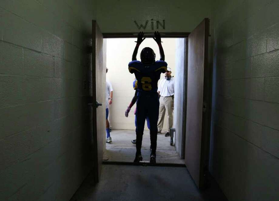 Channelview's Brandon Thomas (6) leaves the locker room to take the field to face the PA Memorial Titans, Saturday, October 15, 2011 at Stallworth Stadium in Baytown. Photo: Eric Christian Smith, For The Chronicle