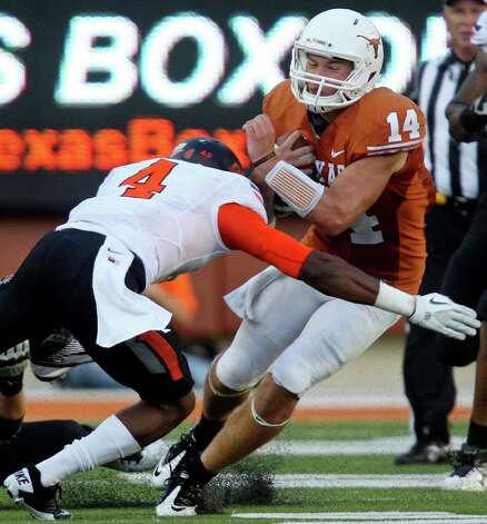 Texas' David Ash is sacked by Oklahoma State's Justin Gilbert during second half action Saturday Oct. 15, 2011at Texas Memorial Stadium in Austin, Tx. Oklahoma State won 38-26. Photo: EDWARD A. ORNELAS, Express-News / © SAN ANTONIO EXPRESS-NEWS (NFS)