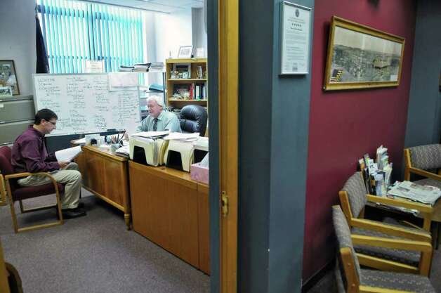 East Greenbush town supervisor Rick McCabe, right, works in his office with town comptroller Jim Breig, left, on Wednesday Oct. 12, 2011 in East Greenbush, NY. ( Philip Kamrass / Times Union) Photo: Philip Kamrass / 00014947A