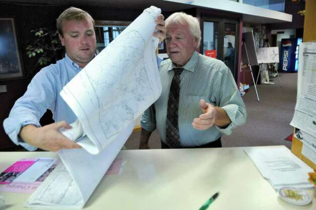 East Greenbush town supervisor Rick McCabe, right, looks over a map of the town with Matt Mastin of the Planning Department, in town hall on Wednesday Oct. 12, 2011 in East Greenbush, NY. ( Philip Kamrass / Times Union) Photo: Philip Kamrass / 00014947A