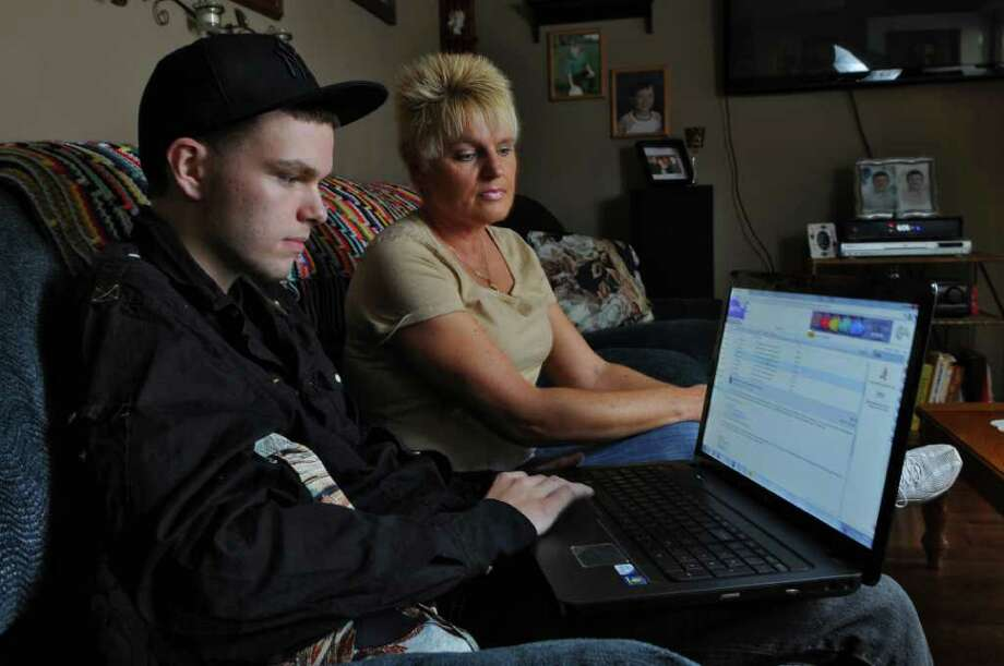 Zach Perez and his mother Kathi Stannard talked about about their negative experience with a company, that isn't local,  that offered to book Zachary's hip hop band for a show at Red Square in Albany, on Tuesday Oct. 11, 2011 in Ravena, NY. ( Philip Kamrass / Times Union) Photo: Philip Kamrass / 00014927A