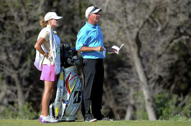 Fred Couples studies the fairway with his caddie Midge Trammell during the second round of the AT&T Championship at TPC San Antonio AT&T Canyons Course on October 12, 2011.  Tom Reel/Staff Photo: TOM REEL, Express-News / © 2011 San Antonio Express-News