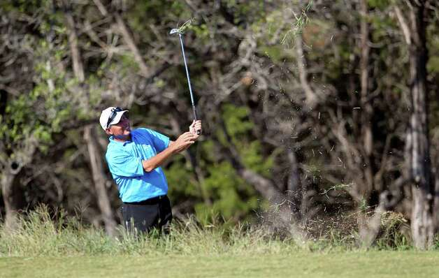 Fred Couples hits out of the rough on 15 during the second round of the AT&T Championship at TPC San Antonio AT&T Canyons Course on October 12, 2011.  Tom Reel/Staff Photo: TOM REEL, Express-News / © 2011 San Antonio Express-News