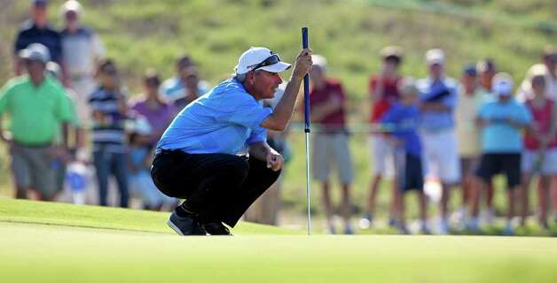 Fred Couples examines his putting line on 16 during the second round of the AT&T Championship at TPC San Antonio AT&T Canyons Course on October 12, 2011.  Tom Reel/Staff Photo: TOM REEL, Express-News / © 2011 San Antonio Express-News