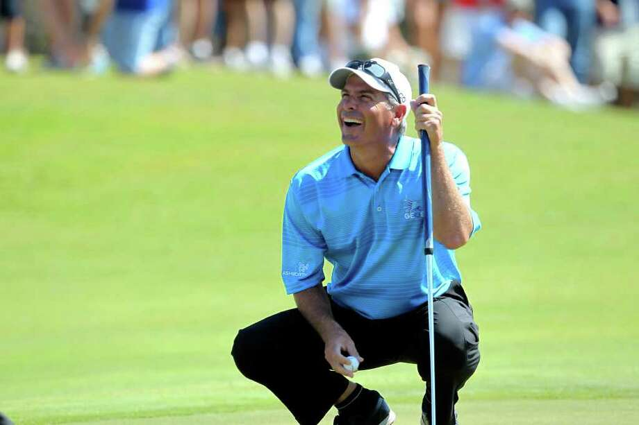 Fred Couples laughs as he places his ball for a birdie putt on the 3rd green during the  second round of the AT&T Championship at TPC San Antonio AT&T Canyons Course on October 12, 2011.  Tom Reel/Staff Photo: TOM REEL, Express-News / © 2011 San Antonio Express-News