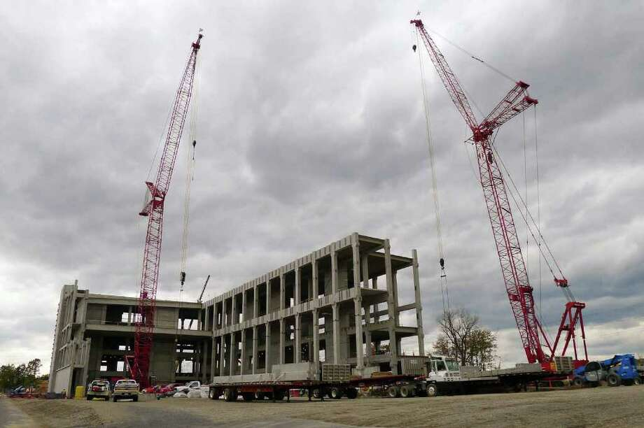 Construction of new nanofab building on north side of Washington Avenue Extension in Albany, NY Saturday Oct. 15, 2011.( Michael P. Farrell/Times Union) Photo: Michael P. Farrell / 00014982A