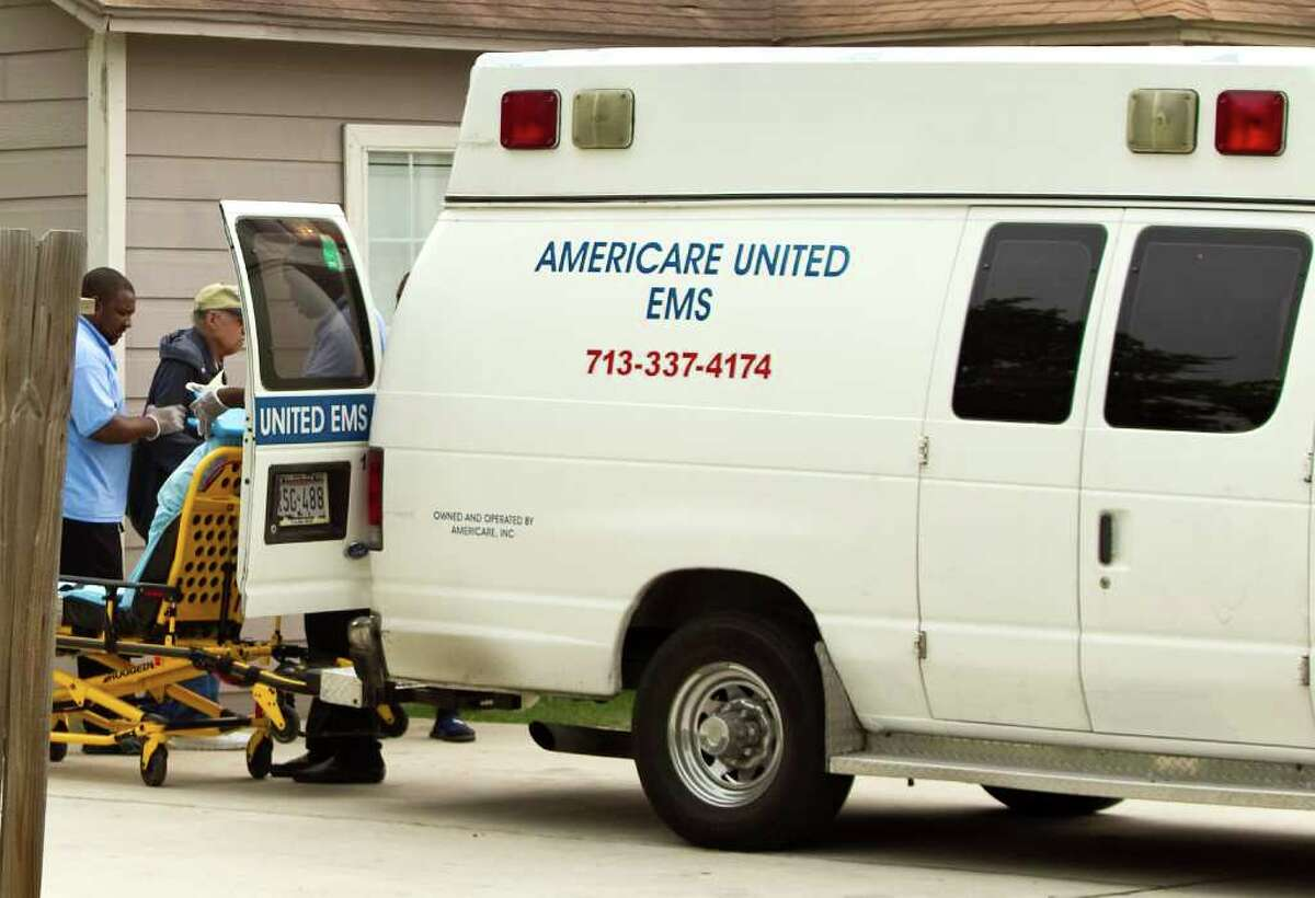 NICK de la TORRE PHOTOS : CHRONICLE LEAVING THE AMBULANCE: An elderly man exits an Americare United EMS ambulance at the Kashmere Garden Residential Care Facility in Houston in July.