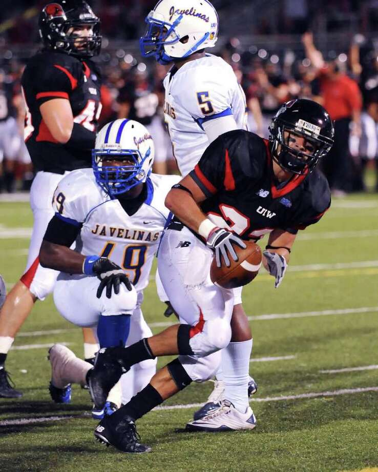Incarnate Word running back Trent Rios scores a touchdown against Texas A&M-Kingsville during college football action at Benson Stadium on Saturday, Oct. 15, 2011.  BILLY CALZADA / gcalzada@express-news.net