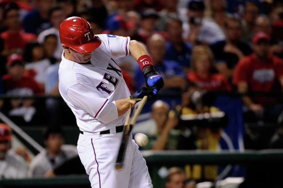 ARLINGTON, TX - OCTOBER 15:  Michael Young #10 of the Texas Rangers breaks his bat as he grounds out in the fifth inning of Game Six of the American League Championship Series against the Detroit Tigers at Rangers Ballpark in Arlington on October 15, 2011 in Arlington, Texas. Photo: Kevork Djansezian, Getty / 2011 Getty Images