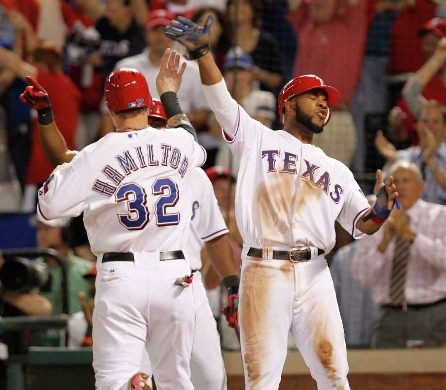 Texas Rangers left fielder Josh Hamilton (32) and Texas Rangers shortstop Elvis Andrus (1) celebrates after scoring in the third inning during Game 6 of the American League Championship Series against the Detroit Tigers in Arlington, Texas, Saturday, October 15, 2011. (Ron T. Ennis/Fort Worth Star-Telegram/MCT) Photo: Ron T. Ennis, McClatchy-Tribune News Service / Fort Worth Star-Telegram