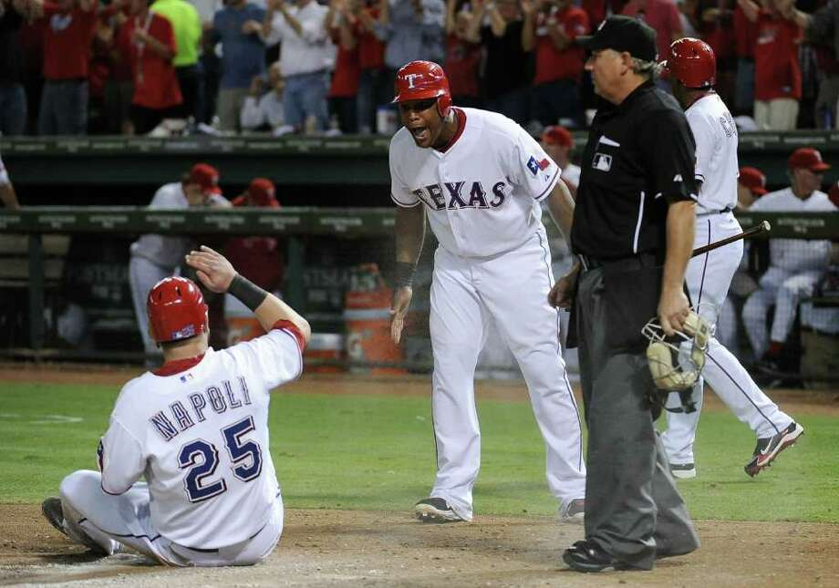 ARLINGTON, TX - OCTOBER 15:  Adrian Beltre #29 of the Texas Rangers reacts as Mike Napoli #25 scores on a single by David Murphy #7 in the third inning of Game Six of the American League Championship Series against the Detroit Tigers at Rangers Ballpark in Arlington on October 15, 2011 in Arlington, Texas. Photo: Harry How, Getty / 2011 Getty Images
