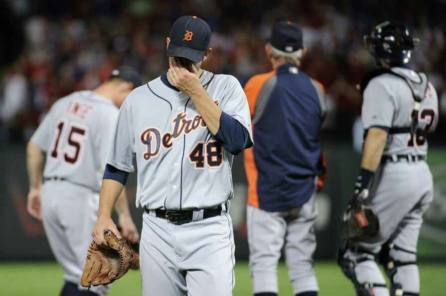 ARLINGTON, TX - OCTOBER 15:  Rick Porcello #48 of the Detroit Tigers reacts after being pulled in th
