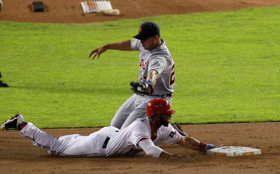Texas Rangers shortstop Elvis Andrus (1) steal second base in the first inning as Detroit Tigers shortstop Jhonny Peralta (27) can't make the tag during Game 6 of the American League Championship Series in Arlington, Texas, Saturday, October 15, 2011. (Rodger Mallison/Fort Worth Star-Telegram/MCT) Photo: Rodger Mallison, McClatchy-Tribune News Service / Fort Worth Star-Telegram