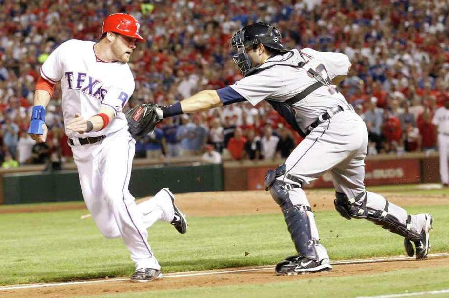 Detroit Tigers catcher Alex Avila (13) tags out Texas Rangers center fielder Craig Gentry (23) in a run down in the third inning of Game 6 of the American League Championship Series in Arlington, Texas, Saturday, October 15, 2011. (Ron T. Ennis/Fort Worth Star-Telegram/MCT) Photo: Ron T. Ennis, McClatchy-Tribune News Service / Fort Worth Star-Telegram