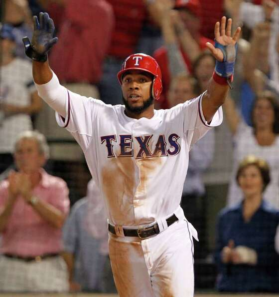 Texas Rangers shortstop Elvis Andrus (1) celebrates after scoring in the third inning during Game 6