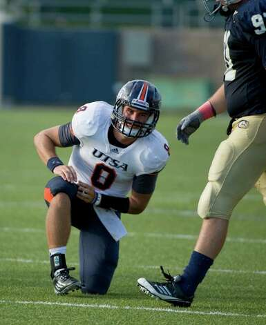 UTSA player, #8, Eric Soza  gets up after a sack during second half action, during the UC Davis Aggies 38-17 victory over the University of Texas at San Antonio Roadrunners, Saturday Oct. 15, 2011. Brian Baer/Special to the San Antonio Express-News Photo: Brian Baer / © 2011 Brian Baer
