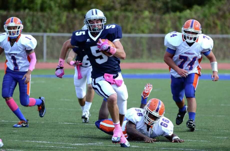 Staples' Nick Kelly (5) carries the ball during the football game against Danbury at Staples High School in Westport on Saturday, Oct. 15, 2011. Photo: Amy Mortensen / Connecticut Post Freelance