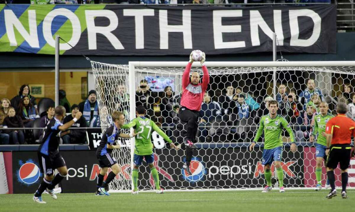 Seattle Sounders FC goalkeeper Kasey Keller, center, leaps for the ball in the first half of a MLS soccer match against the San Jose Earthquakes, Saturday, Oct. 15, 2011, in Seattle. The game is Keller's final regular season home game before retirement.