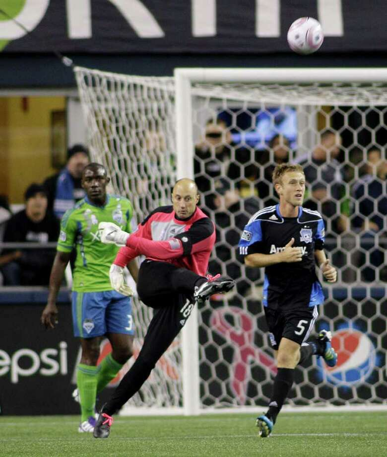 Seattle Sounders FC goalkeeper Kasey Keller, center, kicks the ball after making a save in the first half of a MLS soccer match against the San Jose Earthquakes, Saturday, Oct. 15, 2011, in Seattle. The game is Keller's final regular season home game before retirement. Photo: AP