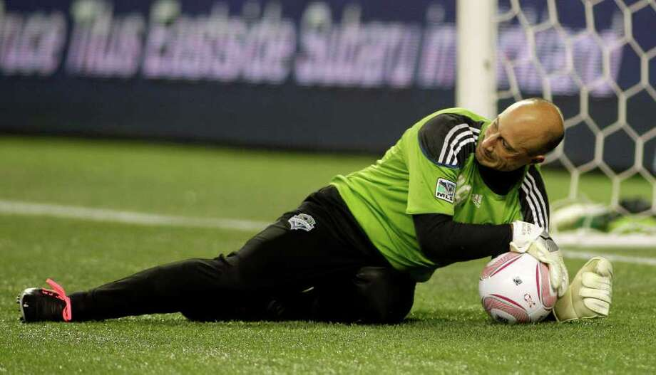 Seattle Sounders FC goalkeeper Kasey Keller wraps up the ball during warm-ups prior to a MLS soccer match against the San Jose Earthquakes, Saturday, Oct. 15, 2011, in Seattle. The game is Keller's final regular season home game before retirement. Photo: AP