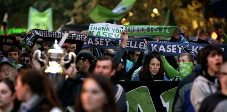 Seattle Sounders FC supporters carry special Kasey Keller scarves in honor of the Sounders goalkeeper, as they march to a MLS soccer match against the San Jose Earthquakes, Saturday, Oct. 15, 2011, in Seattle. The game is Keller's final regular-season game before retirement. Photo: AP
