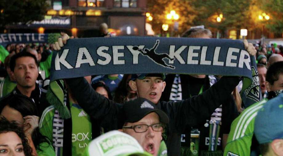 A Seattle Sounders FC supporter carries a special Kasey Keller scarf in honor of the Sounders goalkeeper during the march to a MLS soccer match against the San Jose Earthquakes, Saturday, Oct. 15, 2011, in Seattle. The game is Keller's final regular-season game before retirement. Photo: AP