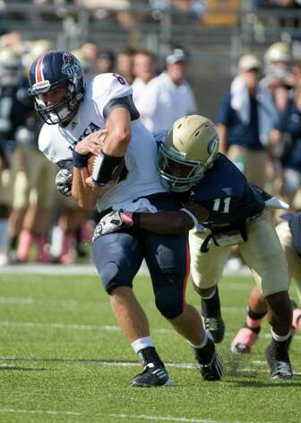 UTSA player, #8, Eric Soza  is sacked by UC Davis player, #11, Jonathan Perkins as the UC Davis Aggies hosts the University of Texas at San Antonio Roadrunners, Saturday Oct. 15, 2011. Brian Baer/Special to the San Antonio Express-News Photo: Brian Baer, Express-News / © 2011 Brian Baer