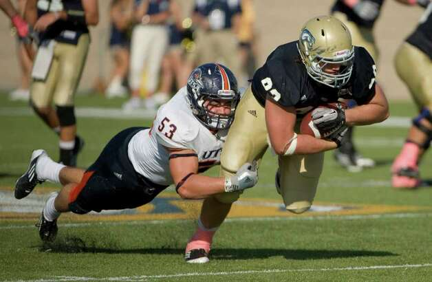 UTSA player, #53, Brandon Reeves  tackles UC Davis player, #83, Michael Cody during second half action, as the UC Davis Aggies 38-17 victory over the University of Texas at San Antonio Roadrunners, Saturday Oct. 15, 2011. Brian Baer/Special to the San Antonio Express-News Photo: Brian Baer, Express-News / © 2011 Brian Baer