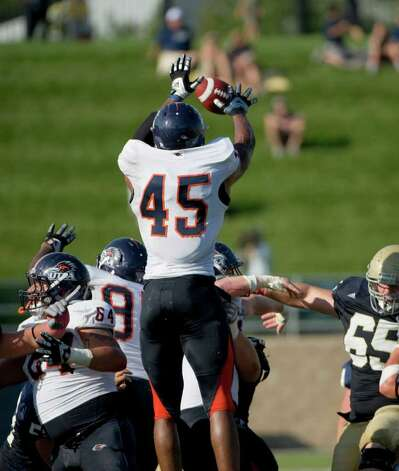 UTSA player, #45, Marlon Smith  blocks a field goal attempt during second half action, as the UC Davis Aggies 38-17 victory over the University of Texas at San Antonio Roadrunners, Saturday Oct. 15, 2011. Brian Baer/Special to the San Antonio Express-News Photo: Brian Baer, Express-News / © 2011 Brian Baer