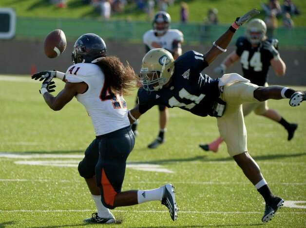 UC Davis player, #11, Jonathan Perkins breaks up a pass intended for UTSA player, #41, CheRod Simpson  during second half action, as the UC Davis Aggies 38-17 victory over the University of Texas at San Antonio Roadrunners, Saturday Oct. 15, 2011. Brian Baer/Special to the San Antonio Express-News Photo: Brian Baer, Express-News / © 2011 Brian Baer