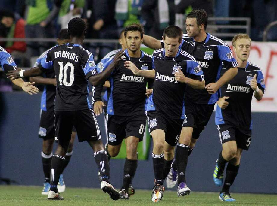 San Jose Earthquakes players celebrate with Chris Wondolowski (8), center, after he scored a goal against Seattle Sounders FC in the first half of a MLS soccer match, Saturday, Oct. 15, 2011, in Seattle. Photo: AP