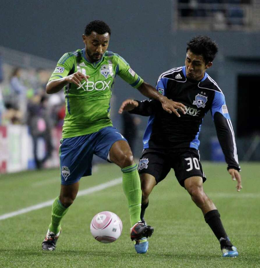 Seattle Sounders FC's James Riley, left, and San Jose Earthquakes' Rafael Baca, right, battle for the ball in the first half of a MLS soccer match, Saturday, Oct. 15, 2011, in Seattle. Photo: AP