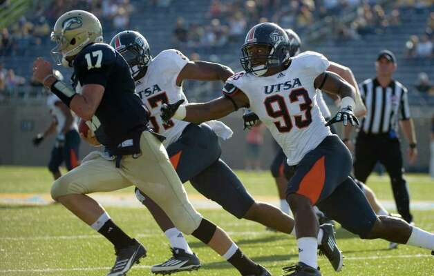UTSA player, #37, Lekenwic Haynes  and UTSA player, #93, Cory Williams  chase UC Davis quarterback, #17, Randy Wrightduring second half action, as the UC Davis Aggies 38-17 victory over the University of Texas at San Antonio Roadrunners, Saturday Oct. 15, 2011. Brian Baer/Special to the San Antonio Express-News Photo: Brian Baer, Express-News / © 2011 Brian Baer