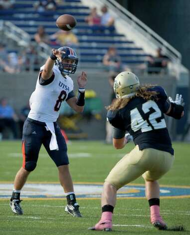 UTSA player, #8, Eric Soza  throws the ball over UC Davis player, #42, Bobby Erskine during second half action, during the UC Davis Aggies 38-17 victory over the University of Texas at San Antonio Roadrunners, Saturday Oct. 15, 2011. Brian Baer/Special to the San Antonio Express-News Photo: Brian Baer, Express-News / © 2011 Brian Baer