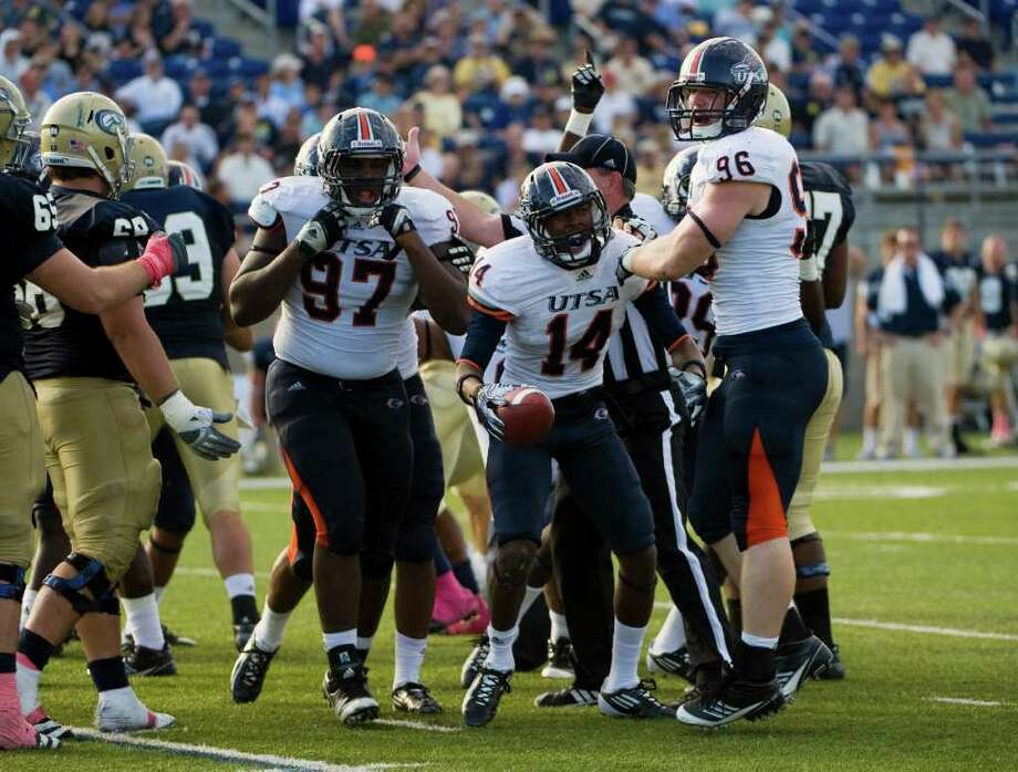 UTSA player, #14, Triston Wade  celebrates his fumble recovery during second half action, during the UC Davis Aggies 38-17 victory over the University of Texas at San Antonio Roadrunners, Saturday Oct. 15, 2011. Brian Baer/Special to the San Antonio Express-News Photo: Brian Baer, Express-News / © 2011 Brian Baer