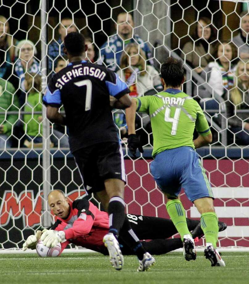 Seattle Sounders FC goalkeeper Kasey Keller makes a stop as Sounders' Patrick Ianni, and San Jose Earthquakes' Khari Stephenson (7) look on in the first half of a MLS soccer match, Saturday, Oct. 15, 2011, in Seattle. The game is Keller's final regular season home game before retirement. Photo: AP