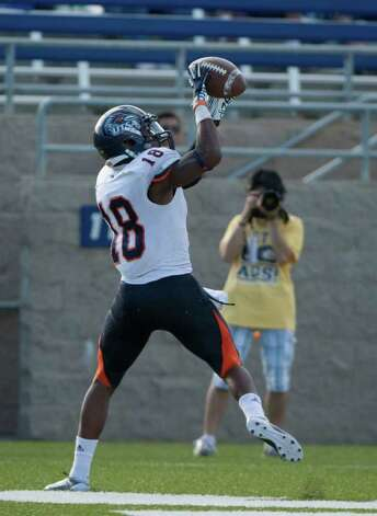 UTSA player, #18, Kenny Harrison catches the ball in the endzone during second half action, during the UC Davis Aggies 38-17 victory over the University of Texas at San Antonio Roadrunners, Saturday Oct. 15, 2011. Brian Baer/Special to the San Antonio Express-News Photo: Brian Baer, Express-News / © 2011 Brian Baer