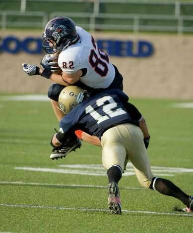 UC Davis player, #12, Charles Boyett tackles UTSA player, #82, David Morgan during second half action, during the UC Davis Aggies 38-17 victory over the University of Texas at San Antonio Roadrunners, Saturday Oct. 15, 2011. Brian Baer/Special to the San Antonio Express-News Photo: Brian Baer, Express-News / © 2011 Brian Baer
