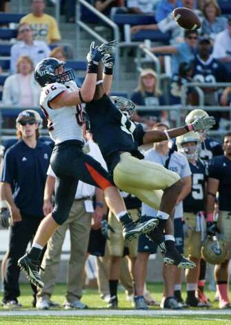 UC Davis player, #17, Randy Wright breaks up a pass intended for UTSA player, #82, David Morgan in the second half, during the UC Davis Aggies 38-17 victory over the University of Texas at San Antonio Roadrunners, Saturday Oct. 15, 2011. Brian Baer/Special to the San Antonio Express-News Photo: Brian Baer, Express-News / © 2011 Brian Baer