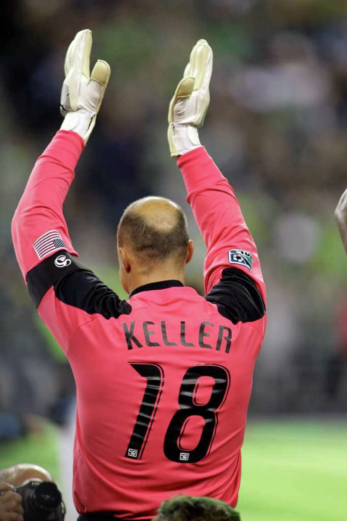 Seattle Sounders FC goalkeeper Kasey Keller applauds the crowd as he stands with his team prior to a MLS soccer match against the San Jose Earthquakes, Saturday, Oct. 15, 2011, in Seattle. The game is Keller's final regular season home game before retirement.