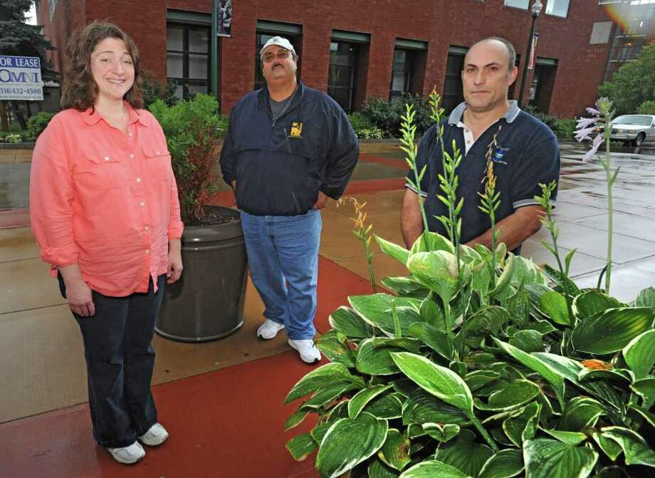 From left, PEF members Susan Olsen, Pete Rea and Tom Giorgio stand behind Proctor's Theatre in Schenectady, N.Y. Monday Oct. 14, 2011. (Lori Van Buren / Times Union) Photo: Lori Van Buren