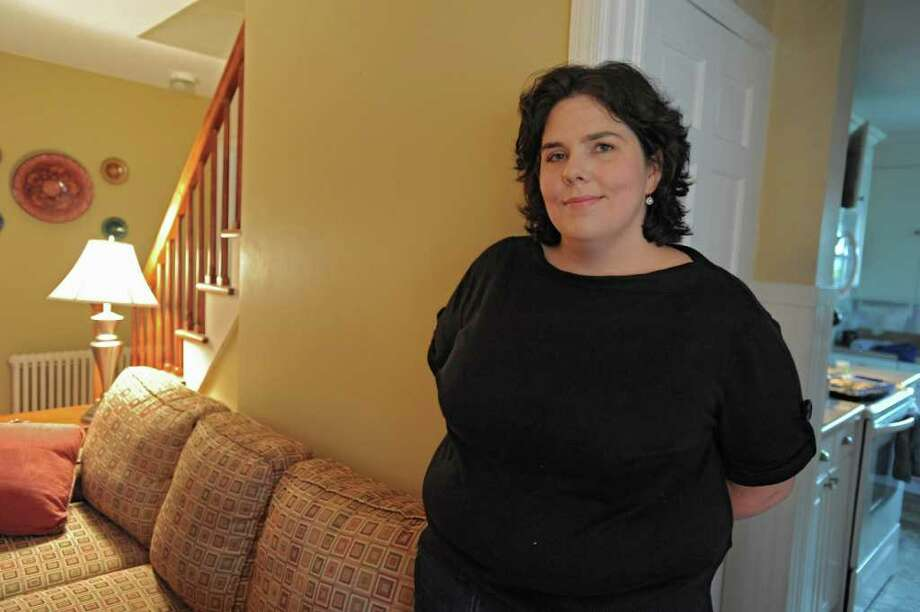 Laura Schultz stands in her living room in Albany, N.Y. Friday Oct. 14, 2011. (Lori Van Buren / Times Union) Photo: Lori Van Buren