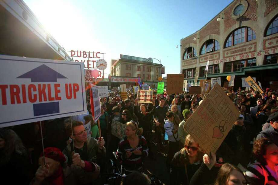 Occupy Seattle protesters march through the Pike Place Market. Photo: JOSHUA TRUJILLO / SEATTLEPI.COM