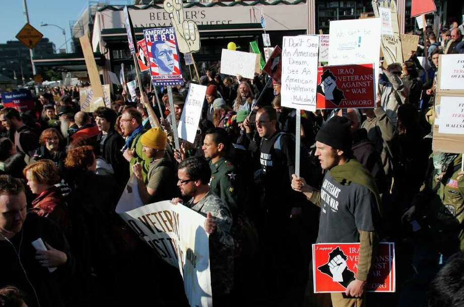 Protesters march through Pike Place Market at an Occupy Seattle rally in downtown Seattle near the Westlake Center on Saturday, Oct. 15, 2011 Photo: JOE DYER / SEATTLEPI.COM
