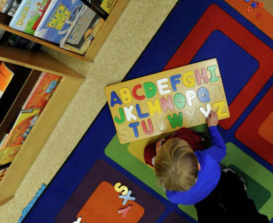 """A student does their """"ABC's"""" while on puzzle time in Mrs. Debra Hoffmann's kindergarten class at the Westmere Elementary School in Westmere, N.Y. October 6, 2011.     (Skip Dickstein/Times Union) Photo: Skip Dickstein / 00014858A"""