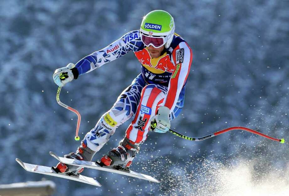 ADVANCE FOR WEEKEND EDITIONS, OCT. 15-16 - FILE - This Jan. 22, 2011 file photo shows Bode Miller of the United States speeding down the course of an alpine ski men's World Cup downhill race, in Kitzbuehel, Austria. The U.S. ski team has invested millions to partner with Copper Mountain and open its own downhill training run at the resort from Nov. 1 to Dec. 10, guaranteeing Olympic medalists such as Lindsey Vonn, Julia Mancuso, Miller and Ted Ligety an early base of solid snow by using 87 snowmaking guns to blanket the nearly 2-mile course.  (AP Photo/Alessandro Trovati, File) Photo: Alessandro Trovati