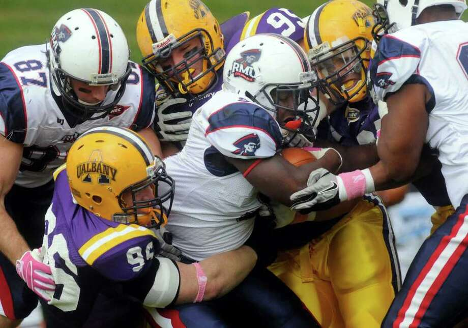 UAlbany defenders bring down Robert Morris's Deontae Howard during their Northeast Conference college football game in Albany, NY Saturday Oct. 15, 2011.( Michael P. Farrell/Times Union) Photo: Michael P. Farrell