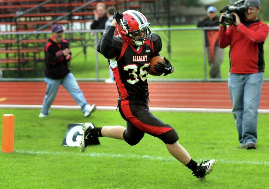 Academy's David Bryce (36) pumps his fist as he makes a touchdown during their football game against Ravena on Saturday, Oct. 15, 2011, at Albany Academy in Albany, N.Y. (Cindy Schultz / Times Union) Photo: Cindy Schultz / 00014944A