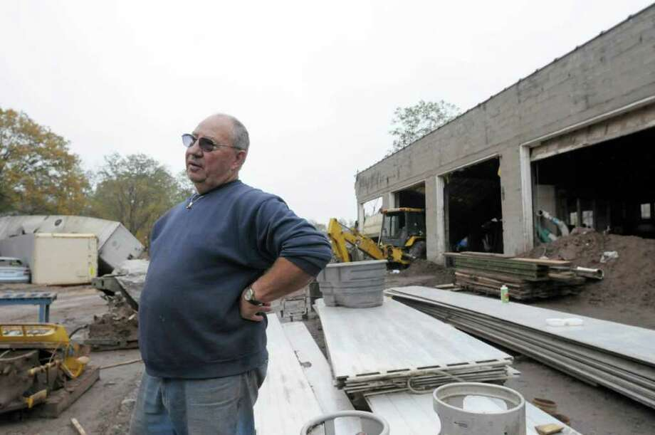 Bill Briggs stands outside of Dimensional Hard Woods on Main St. in Prattsville on Thursday, Oct. 13, 2011.  The business along with many other businesses and homes in the town  was badly damaged by Tropical Storm Irene and the flooding it brought.  (Paul Buckowski / Times Union) Photo: Paul Buckowski / 00014959A